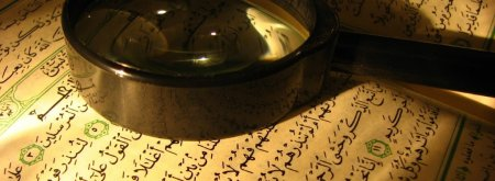 Quran and magnifying glass